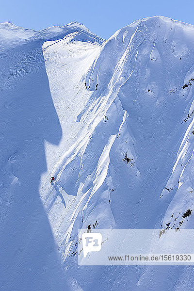 Professional Snowboarder Marie France Roy  rides fresh powder on a sunny day while snowboarding in Haines  Alaska.