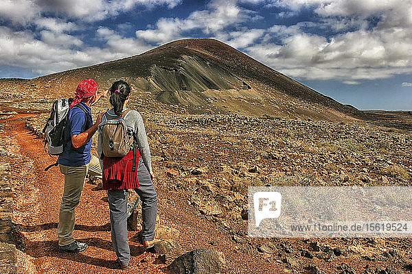 Hikers Exploring La Oliva Mountain In Fuerteventura Island Of Spain