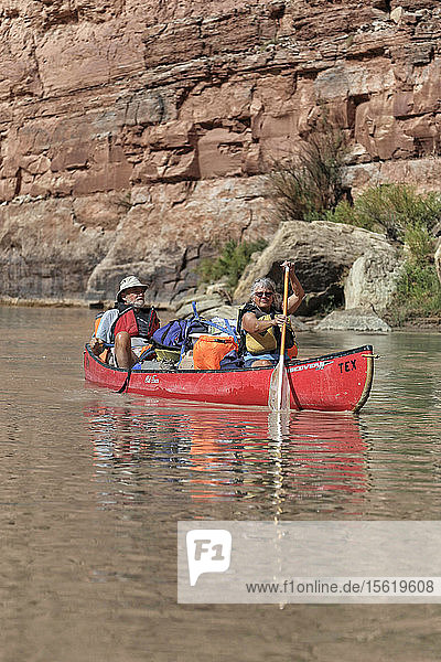 An Athletic Elderly Couple Canoeing On The Green River In Canyonlands National Park  Utah