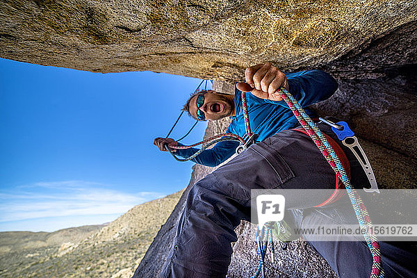 A man belays a technical rock climb in Joshua Tree National Park  California.