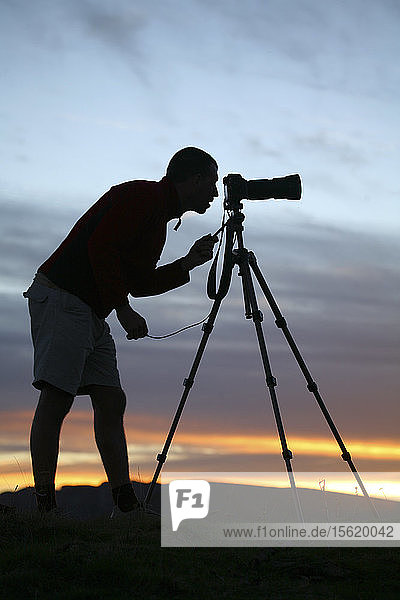 Silhouette of a photographer composing a picture