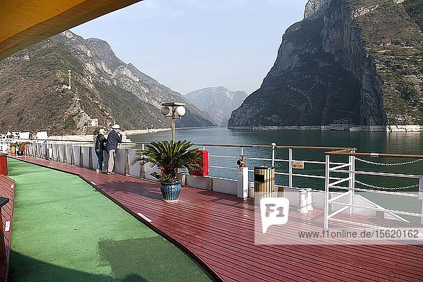 Couple cruising the Yangtze River near the Three Gorges Dam  China  aboard the Sinorama Gold 8 riverboat.