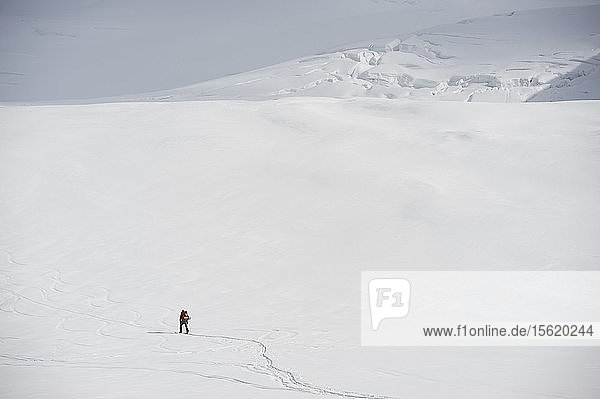 Team ascends to 11 000-feet on the Sheep Glacier during ski ascent of Mount Sanford in the Wrangell-St. Elias National Park outside of Glennallen  Alaska June 2011. Mount Sanford at 16 237 feet is the sixth tallest mountain in the United States. (Model Release: Patrick Gilroy)