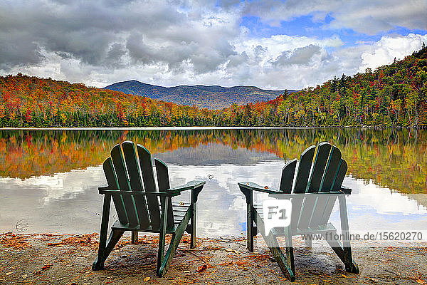 Two Adirondack Chairs On The Bank Of Heart Lake At Adirondack Park