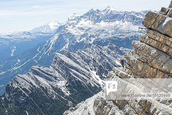 Man Climbing At The Via Ferrata Ivano Dibona In Dolomites  Italy