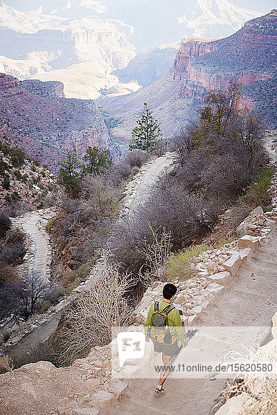 Looking down on a female hiker as she walks down the South Kaibab Trail in the Grand Canyon National Park.
