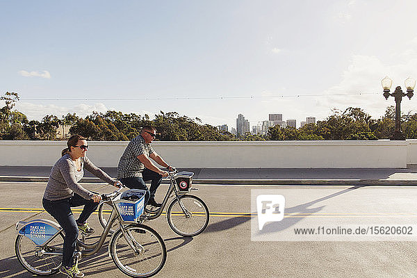 A couple ride bikes in Balboa Park in San Diego on Dec. 12,  2015.