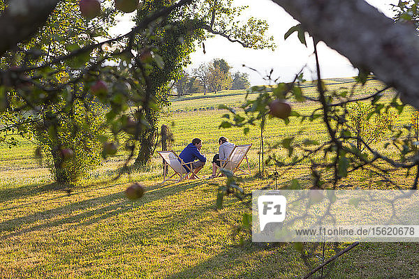 Two guests enjoy the warm sunlight at the tourist farm Janezinovi in the village of Ratecevo Brdo  which is part of the Ilirska Bistrica municipality  in south-eastern Slovenia. The homestead is located at an elevation of 500 m above the sea level  amidst pleasant nature and far away from the city hustle and bustle. The spot is ideal either for rest or entertainment as the surrounding meadows  pastures and forests present an excellent environment in which to relax and reconnect with nature.