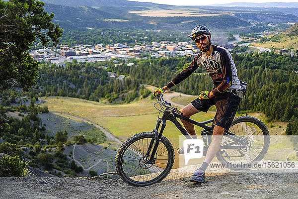 Male Mountain Biker stops for a breather on a technical downhill section just outside of Durango  Colorado