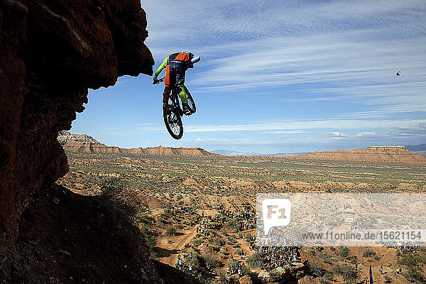 Rear view of person jumping over mountains during daytime,  Utah,  USA
