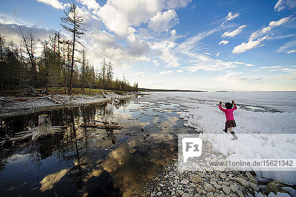 Little Girl Playing On The Lake Covered With Ice At Mongolia