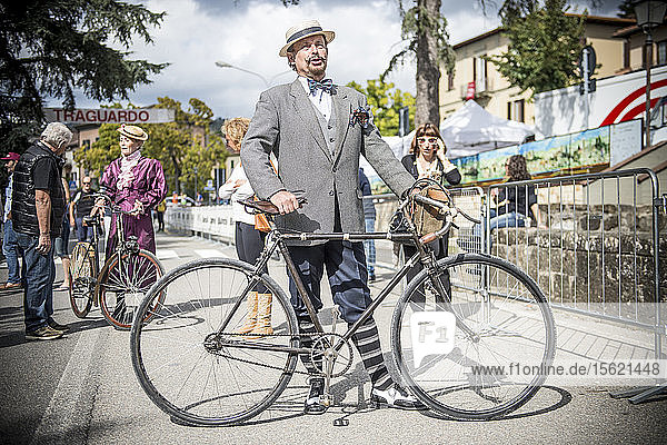 An elegant man dressed in vintage style. Eroica is a cycling event that takes place since 1997 in the province of Siena with routes that take place mostly on dirt roads with vintage bicycles. Usually it held on the first Sunday of October.