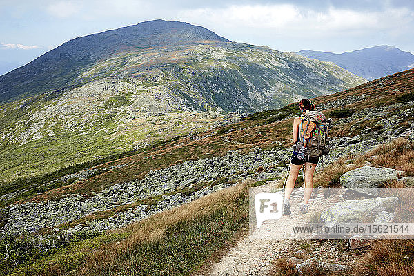 An Appalachian thru hiker walking the trail in New Hampshire���s White Mountains.