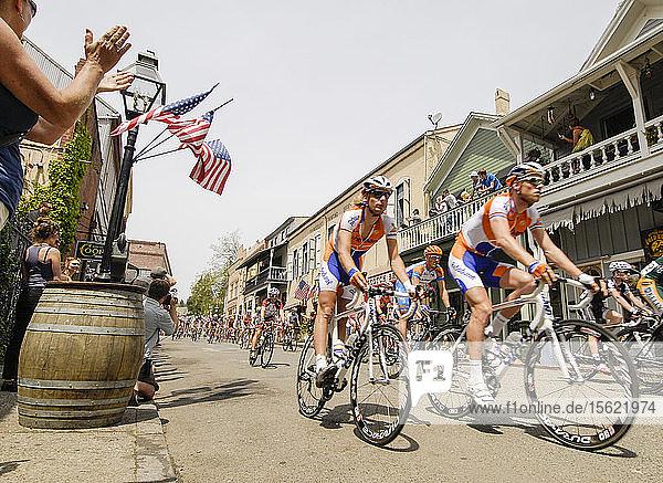 Tour of California bike race passing through historic gold mining town of Nevada City  California