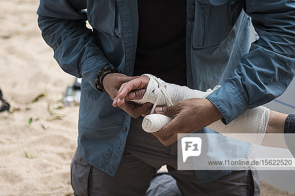 Amputation bandaging technique being explained during a wilderness first responder WFR course  El Aguacero waterfall  Chiapas  Mexico