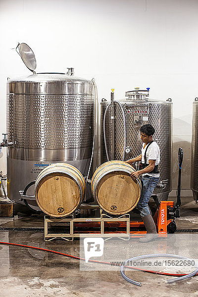 Workers checks casks for leaks before cleaning them for a new batch of wine at Delaplane Vineyards  Deplane  Virginia. Casks from Europe can cost over $1 600 apiece  but can be used for multiple batches of wine.