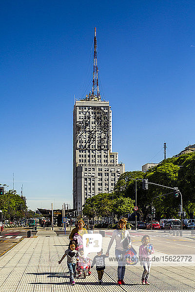 Front view shot of family walking on street in Buenos Aires  Argentina