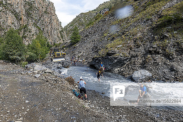Crossing washed out road trekking in Republic of Georgia