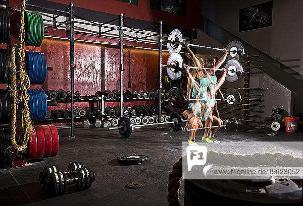 Multiple exposure of a crossfit athlete performing a barbell exercise at a gym in San Diego  California.