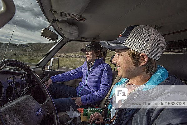 Two women travel in a 1990 Toyota Land Cruiser while on a road trip in Montana.