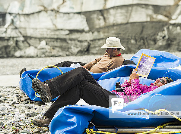 Rafter Reading Guidebook While Resting On Raft