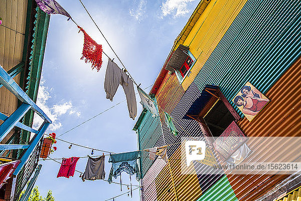 Colorful buildings and hanging laundry in the La Boca district of Buenos Aires  Argentina