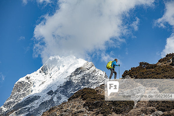 Side view of man hiking near Mount Everest  Dingboche  Khumbu  Solukhumbu District  Nepal