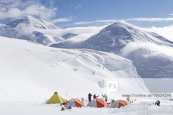 Mountaineers meeting each other in a camp with tents at 12.000 feet on Denali  Alaska.