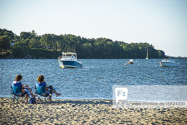People enjoying a summer evening at the beach in Rhode Island