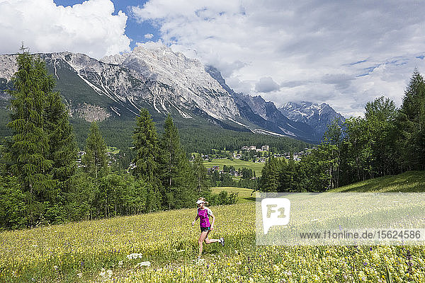 Woman Trail Running Near Cortina D'ampezzo In Italy
