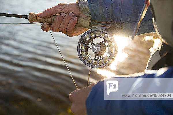 Angler Fishing With His Orvis Fly Reel