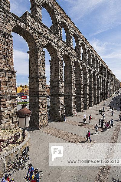 Tourist Exploring The Roman Aqueduct In Segovia  Spain