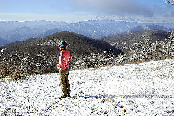 An Appalachian Trail thru hikers pauses to take in a view along the Appalachian Trail. Snow is common in the Mountains of GA in March.