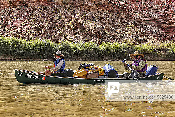 Couple Canoeing On The Green River In Canyonlands National Park  Utah