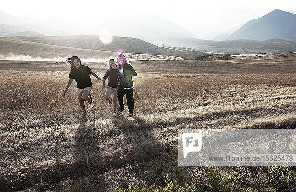 three girls running in peru