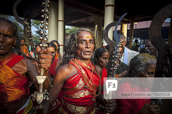 Kodungalloor Bharani is a temple festival  a congregation of oracles (Vellichapads). Dressed in red  with untied hair  brandishing their swords both men and women Komarams create an electric atmosphere.The oracles perform a mad run around the temple. They throw objects inside the temple mainly sticks which signifies the Kavutheendal. The oracles also sing numerous songs that are associated with the legend of the Goddess and those associated with farming  culture and mother earth. Another highlight is the hurling of abuses at the deity ��� locally known as Kodungalloor Bharani Pattu. The lyrics of the song contain mostly sexually explicit words ��� most of which are abusive.