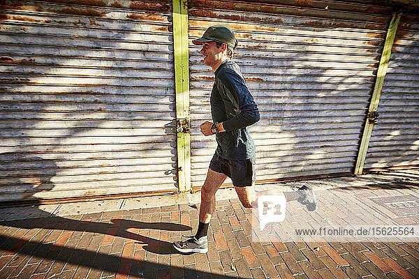 Man Running Through City Streets In Boston