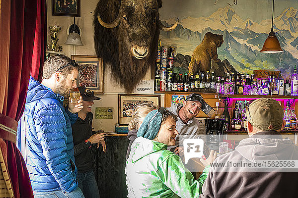 Group of people laughing while taking in inn  Talkeetna  Alaska  USA