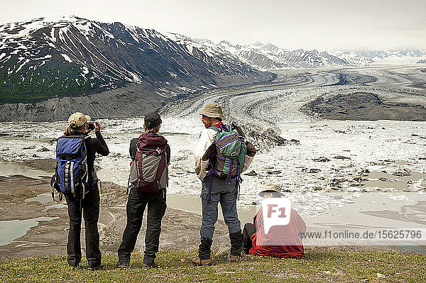 Group Of Hikers Relaxing On Goatherd Mountain Above Lowell Lake  Alsek River  Canada