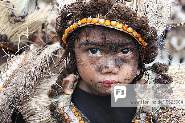 Beautiful little girl with black smeared faces wearing tribal costume at Ati Atihan festival  Kalibo  Aklan  Panay Island  Philippines