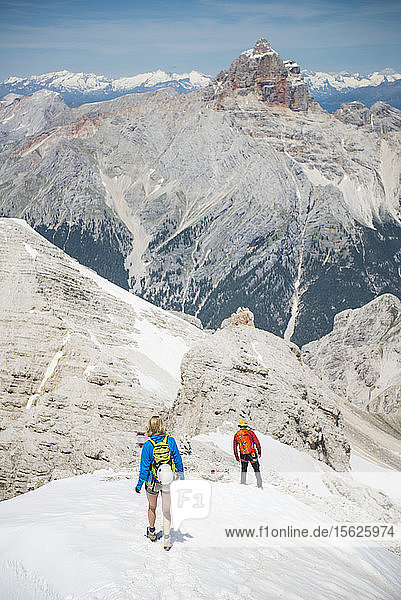 Couple Climbing Down At The Via Ferrata Ivano Dibona In Dolomites  Italy