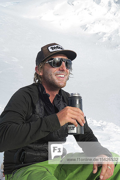 A Happy Mountaineer Is Enjoying A Brief Moment Of Sunny And Warm Weather High Up On Denali
