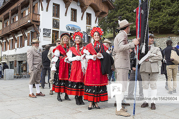 A group of Italian mountain guides are dressed in traditional clothing of the Guide Alpine Courmayeur for a parade through the village of Courmayeur.