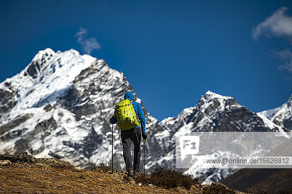 Rear view of man hiking in Everest Region  Pheriche  Khumbu  Solukhumbu District  Nepal