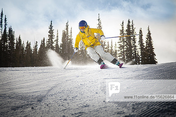 A local skier in Aspen  Colorado surveys the mountain on a morning run.