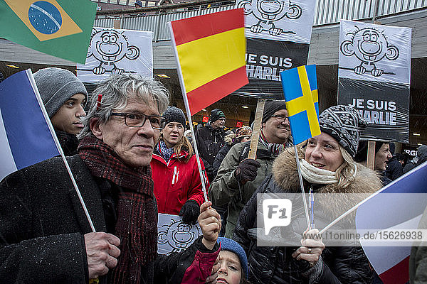 Demonstration in the snow storm at Sergels torg in Stockholm where thousands of people come to listen to French ambassador for freedom of speech and against the terrorist attack in Paris France.