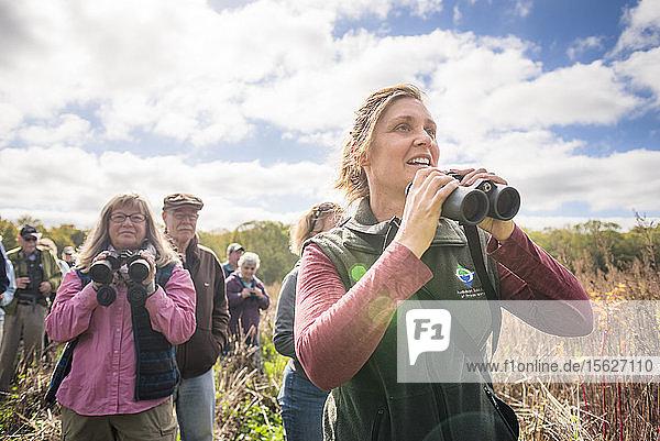 Woman with binoculars during bird watching with Audubon Society  Johnston  Rhode Island  USA