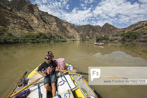 Man paddling in raft down Green River on Desolation/Gray Canyon section  Utah  USA