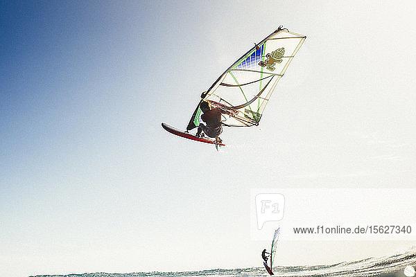 Professional windsurfer in mid-air  El Cabezo  Tenerife  Canary Islands  Spain Professional windsurfer in mid-air, El Cabezo, Tenerife, Canary Islands, Spain