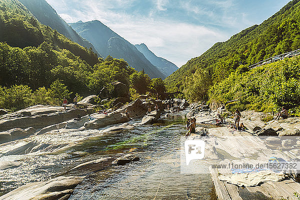 Mountainscape with forest and climbers relaxing near river  �Valle Verzasca  �Ticino  Switzerland